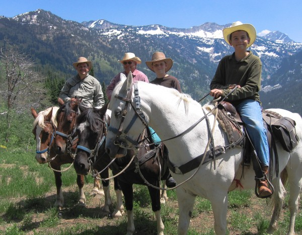 family stops for a photo on the way to Crow's Nest, Grand Teton Horseback Riding Trails